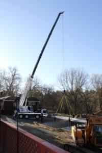 Crane lifting garage subfloor