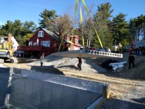 Crane guiding subfloor into place