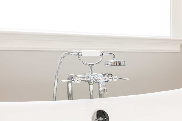 Tub filler in chrome and white
