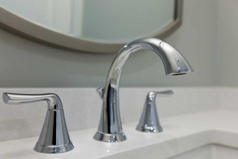 Faucet closeup in white bathroom