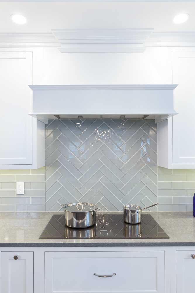 cooktop with herringbone glass tile